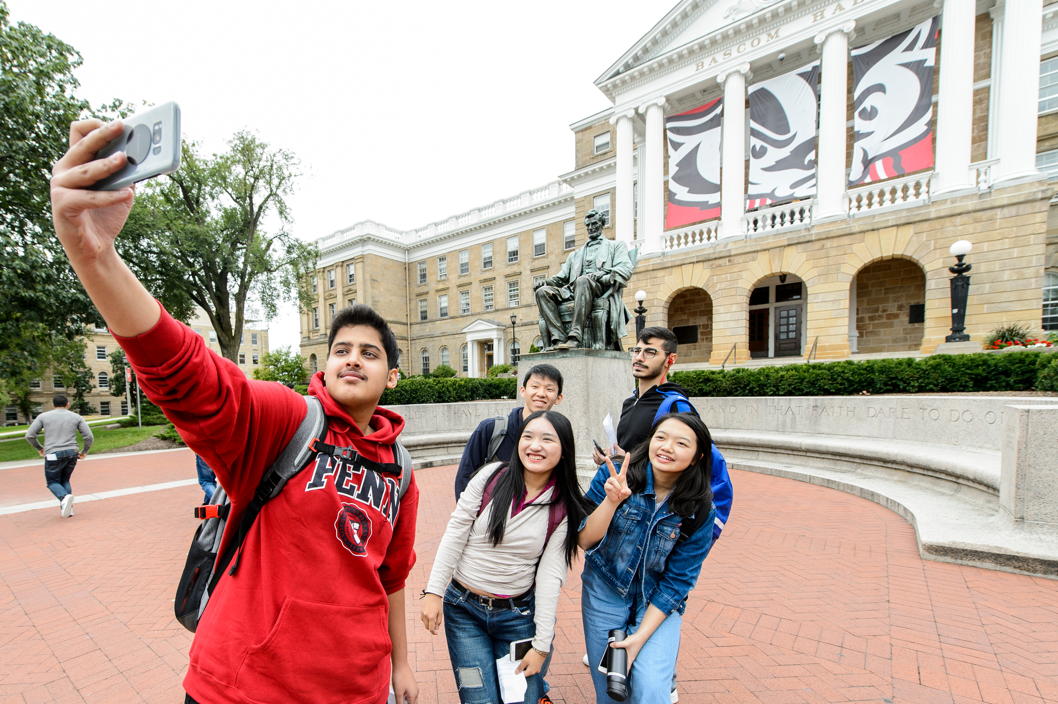 student taking selfie in front of bascom hall