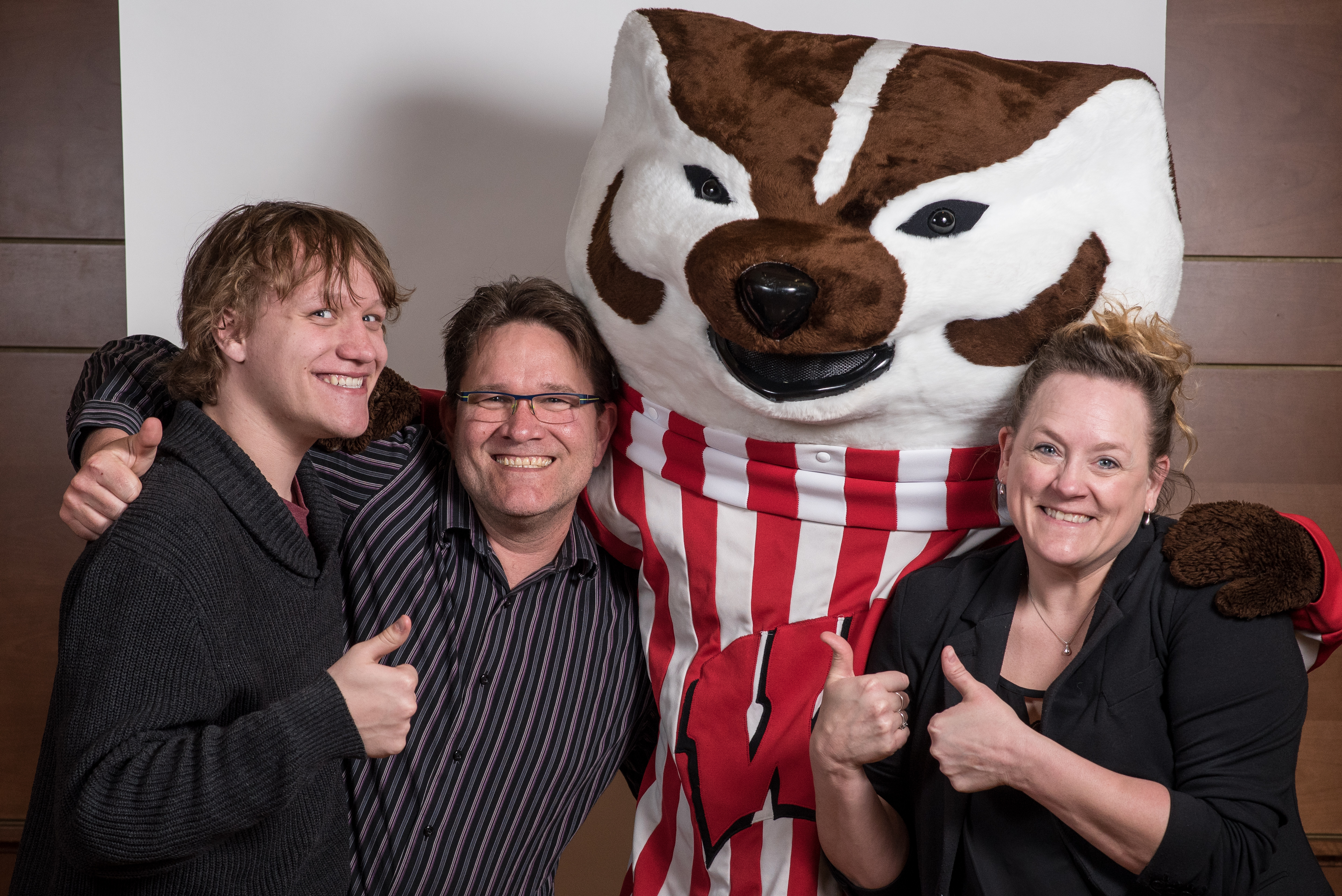 student and family with Bucky at reception