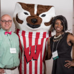 student and spouse with Bucky at reception