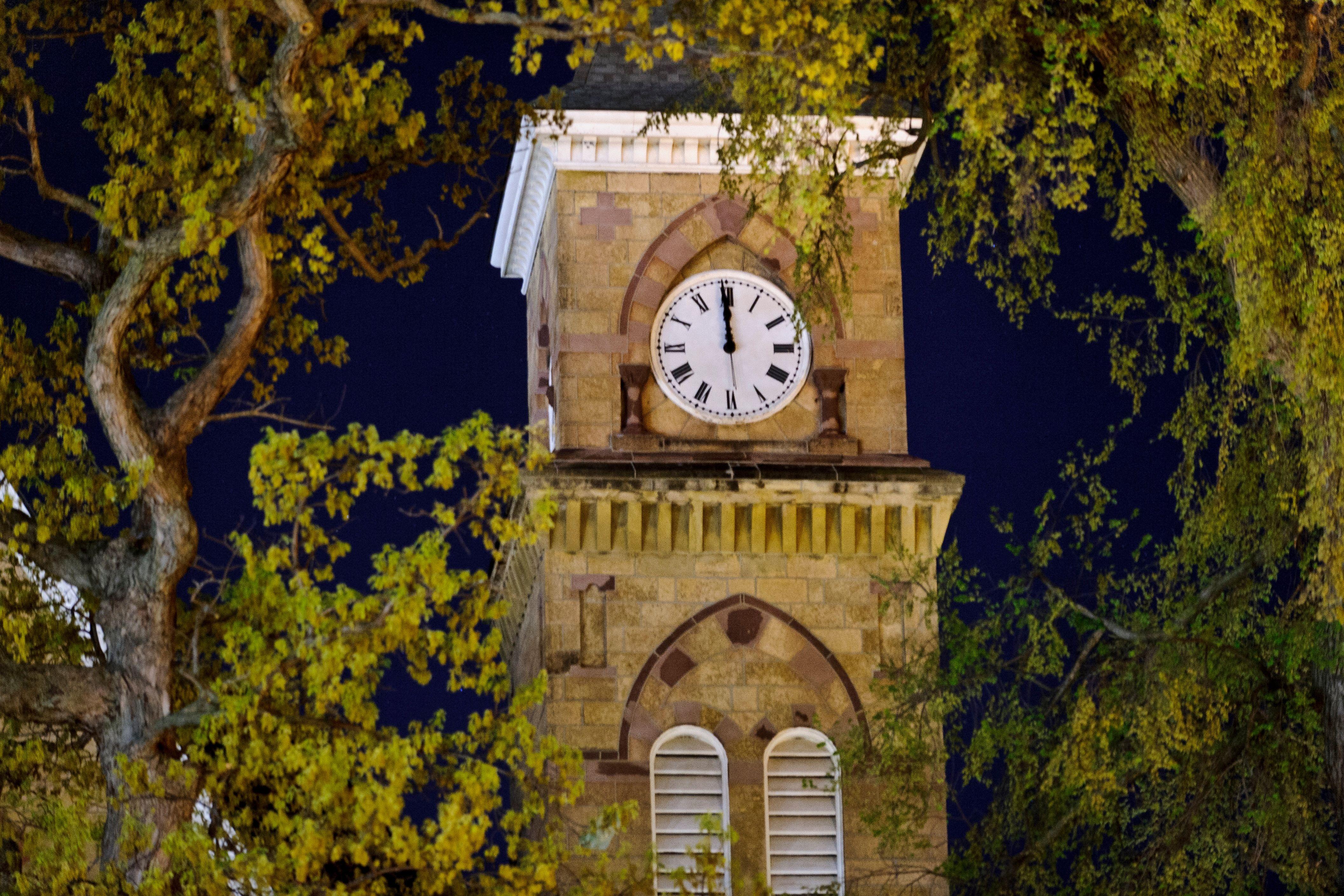 music hall clock at night